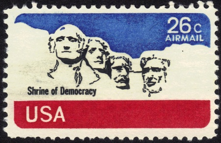 USA-CIRCA 1974  A stamp printed in USA shows stone sculptures of George Washington, Thomas Jefferson, Theodore Roosevelt, and Abraham Lincoln, circa 1974