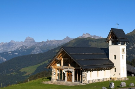 beautiful chapel in the mountains of Switzerland photo