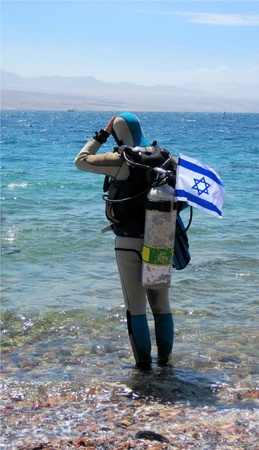 Independence Day of Israel diver preparing to dive in the Red Sea Stock Photo - 13558847