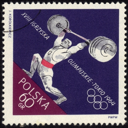POLAND - CIRCA 1964: a stamp printed by POLAND shows the athlete raises a barbell., Series, circa 1964