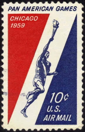 UNITED STATES OF AMERICA - CIRCA 1959  A stamp printed in the United States of America shows Runner Holding Torch, 3rd Pan American Games, Chicago, circa 1959 Stock Photo - 13601938