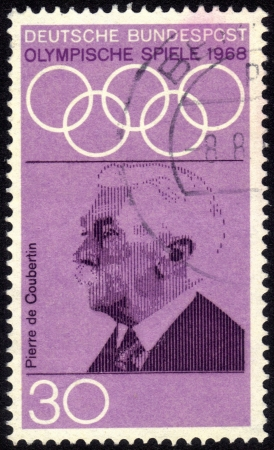 coubertin: Germany - CIRCA 1968: a stamp printed by Germany shows Portrait of Pierre de Coubertin, dedicated to the 19th Olympic Games, Mexico City, circa 1968 Editorial