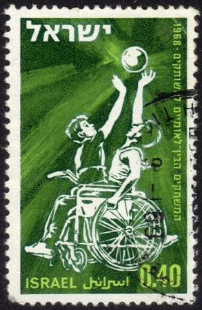 Israel - CIRCA 1968  a stamp printed by Israel shows basketball players sitting in a wheelchair  International games for the paralysed in Israel, circa, 1968