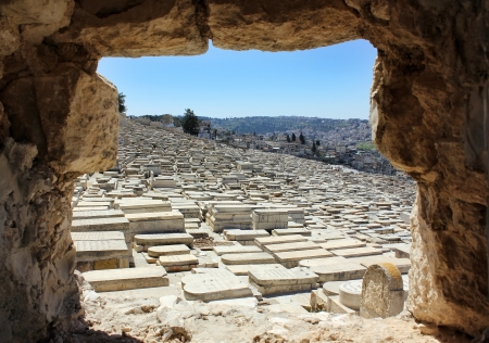 view of the old Jewish cemetery through the embrasure in the wall of ancient Jerusalem