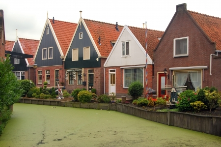 Holland, Volendam (Amsterdam), typical dutch stone houses and a water canal