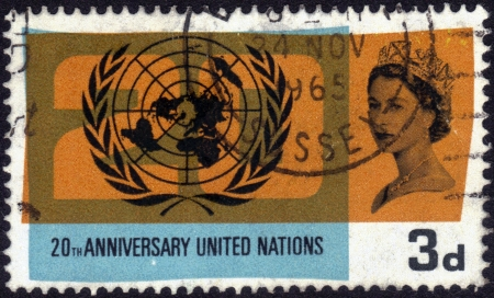 United Kingdom-CIRCA 1965: stamp printed in the United Kingdom, shows images of Queen Elizabeth II and the symbol of united nations, dedicated to 20th anniversary united nations, series, circa 1965 Stock Photo - 13929494