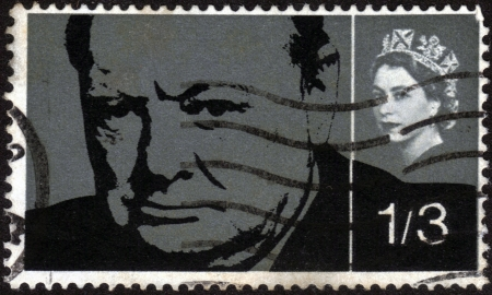 minister of war: UNITED KINGDOM - CIRCA 1965  A stamp printed in England, shows Sir Winston Spencer Churchill and queen Elizabeth, circa 1965