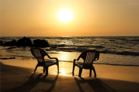 two empty chairs on the beach waiting for lovers, that would carry out the sunset