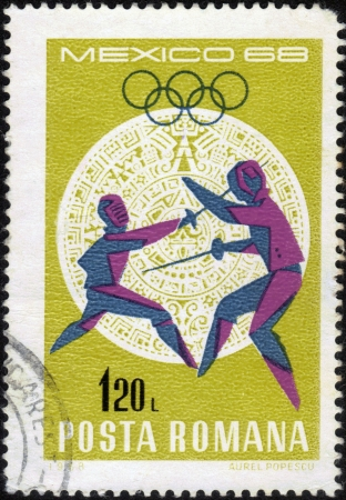 Romania - CIRCA 1968: a stamp printed by Romania, shows fencing the rapier. Olympic Games in Mexico City in 1968, series, circa 1968