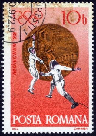 Romania - CIRCA 1972: a stamp printed by Romania, shows fencing the rapier. Olympic Games in Munich, Germany in 1972, series, circa 1972 Stock Photo - 14136849