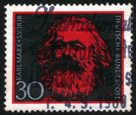 Germany - CIRCA 1968: A Stamp printed in the Germany shows portrait Karl Marx (1818-1883), dedicated to the 150th anniversary of his birth, circa 1968. Stock Photo - 14136844