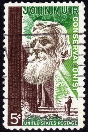 conservationist: UNITED STATES OF AMERICA - CIRCA 1964: a stamp printed in the United States of America shows John Muir, American naturalist and conservationist, circa 1964 Editorial