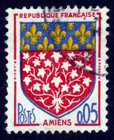 FRANCE - CIRCA 1962: A stamp printed in France, depicts arms of the city Amiens, the capital of the Somme department in Picardy in France, circa 1962 Stock Photo - 14046502