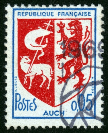 gascony: France - CIRCA 1969: A postage stamp printed in France, shows the historical coat of arms of Auch in France , Auch is the historical capital of Gascony , circa 1969 Stock Photo