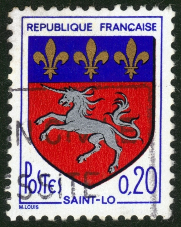France - CIRCA 1966: A postage stamp printed in France, shows the historical coat of arms of Saint-lo in France , the capital of the Manche department in Normandy , circa 1966 Stock Photo - 14046491