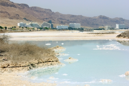 salt deposits in the Dead Sea and the views of the resort area, Israel photo