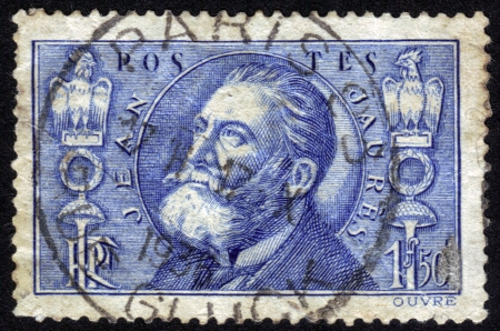 France - CIRCA 1935: A postage stamp printed in France, shows the pacifist and leader of French Socialist Jean Jaures 1859 31 July 1914,  was assassinated by nationalist Raoul Villain,  circa 1935