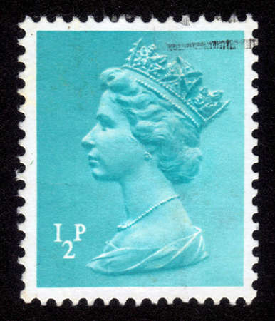 UNITED KINGDOM - CIRCA 1971: A stamp printed in United Kingdom showing a portrait of Queen Elizabeth II on turquoise background , circa 1971. Stock Photo - 14141476