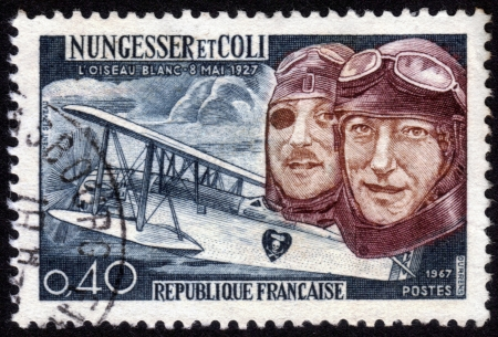 attempted: France - CIRCA 1967: A postage stamp printed in France, shows Charles Nungesser and Francois Coli, were French aviation pioneers. They attempted  to cross the Atlantic ocean , they  disappeared in May 9, 1927. crashed in the Atlantic ocean , circa 1967