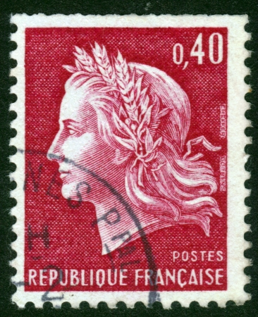 FRANCE - CIRCA 1969: A stamp printed in France, depicts Marianne (by Cheffer) Marianne is a national emblem of France and an allegory of Liberty and Reason, circa 1969 Stock Photo - 14141471