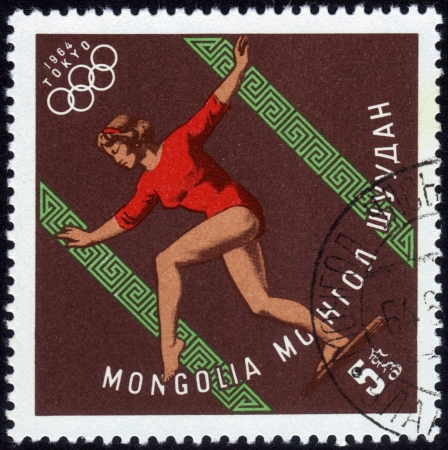 MONGOLIA - CIRCA 1964  A stamp printed in MONGOLIA shows Gymnastics women s with the inscription  Tokyo, 1964 ,  series  XVIII Summer Olympic Games, Tokyo, 1964 , circa 1964 Stock Photo - 14147859