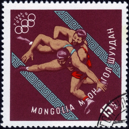 MONGOLIA - CIRCA 1964: A stamp printed in MONGOLIA shows wrestling with the inscription