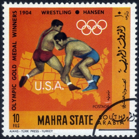 South Arabia - CIRCA 1968: A stamp printed in Mahra State of South Arabia shows an image of American sportsman Hansen, the winner in wrestling in Olympic Games in St. Louis , Missouri 1904, series, circa 1968 Stock Photo - 14147234