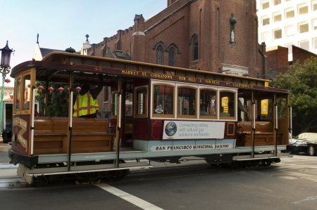 SAN FRANCISCO, USA - MAY 25 , 2012, Passengers enjoy a ride in a cable car in San Francisco, oldest mechanical public transport in San Francisco, since 1873 , SAN FRANCISCO, USA-MAY 25, 2012