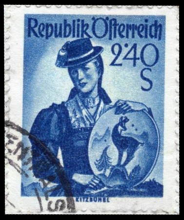 AUSTRIA - CIRCA 1951  A stamp printed in Austria, shows a woman in national dress, Tyrol, inscription Kitzbuhel from the series  Costumes  , circa 1951 Stock Photo - 14132097