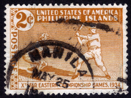 United States of America (Philippine islands) - CIRCA 1935: a stamp printed in United States of America, shows players in baseball, to commemorate the Tenth Far Eastern Championship Games, a sort of regional olympics, history of Baseball, circa 1935 photo