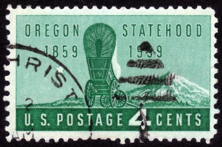 USA - CIRCA 1959: A Stamp printed in USA shows the covered Wagon and Mount Hood, Oregon Statehood , Centenary, circa 1959 Stock Photo - 14132125
