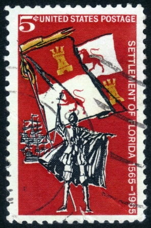 UNITED STATES OF AMERICA - CIRCA 1965: a stamp printed in the USA shows Spanish Explorer, Royal Flag and Ships, is dedicated to 400th anniversary of the first settlement in the USA St. Augustine, Florida, circa 1965 Stock Photo - 14132438