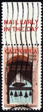 UNITED STATES OF AMERICA - CIRCA 1969: stamp printed in USA, shows Carmel  Belfry at the Basilica of Mission San Carlos Borromeo del Rio Carmelo - Carmel California , circa 1969 Stock Photo - 14132459