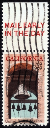 UNITED STATES OF AMERICA - CIRCA 1969: stamp printed in USA, shows Carmel  Belfry at the Basilica of Mission San Carlos Borromeo del Rio Carmelo - Carmel California , circa 1969 Stock Photo - 14132459