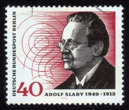 Germany - CIRCA 1974: A stamp printed in Germany, shows a portrait of Adolf Karl Heinrich Slaby (1849-1913), was a German wireless pioneer and the first Professor of electro-technology at the Technical University of Berlin, circa 1974 Stock Photo - 14242382