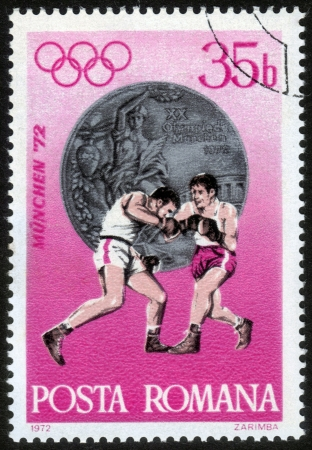Romania - CIRCA 1972: a stamp printed by Romania, shows fight boxers. Summer Olympic Games in Munich, Germany in 1972, series, circa 1972 Stock Photo - 14242386