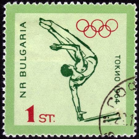 Bulgaria - CIRCA 1964: A stamp printed in Bulgaria shows Gymnastics men with the inscription