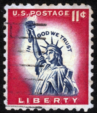 USA - CIRCA 1954: A stamp printed in USA, shows the Statue of Liberty, the inscription in God We Trust, circa 1954. Stock Photo