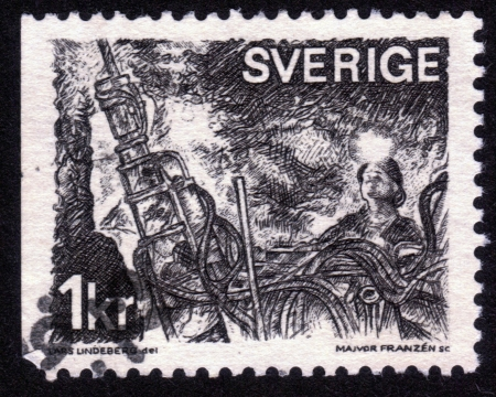 Sweden - CIRCA 1970: A stamp printed in the Sweden shows the working miners, circa 1970 Stock Photo - 14264307