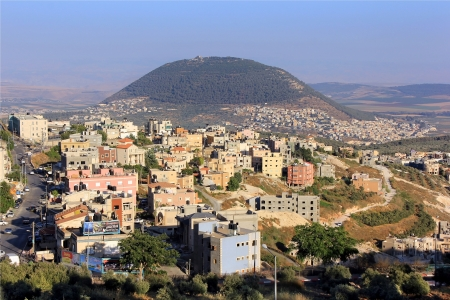 view of the biblical Mount Tabor and the Arab village Stock Photo