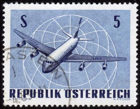 AUSTRIA - CIRCA 1960: A stamp printed in Austria, shows a Four-engine Jet Airliner , circa 1960 Stock Photo - 14304203