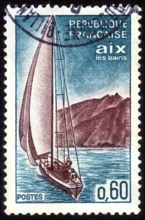 FRANCE - CIRCA 1965: stamp printed by France, shows Aix-les-Bains, sailboat, circa 1965 Stock Photo - 14304190