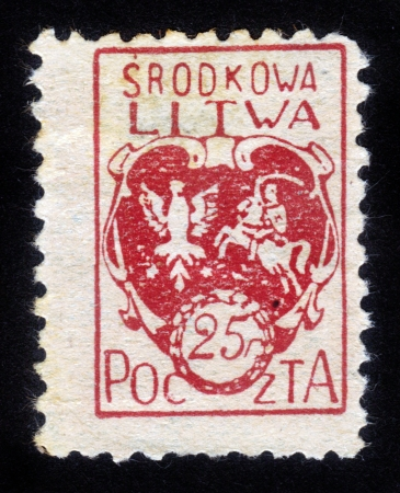 Republic of Lithuania Median (litwa srodkowa) - CIRCA 1920: A stamp printed in the Republic of Lithuania  Median shows  coat of arms of unrecognized state , on the territory of modern Lithuania and Belarus (1920 - 1922), circa 1920 photo