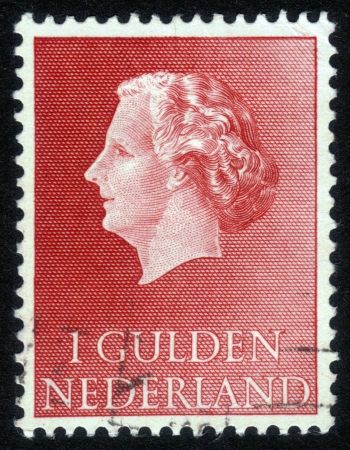 NETHERLANDS - CIRCA 1960: Stamp printed in the Holland shows  the queen Juliana, circa 1960 Stock Photo - 14326660