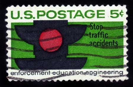 prohibits: USA - CIRCA 1965: stamp printed in the United States shows the traffic signal red color, which prohibits the movement, circa 1965