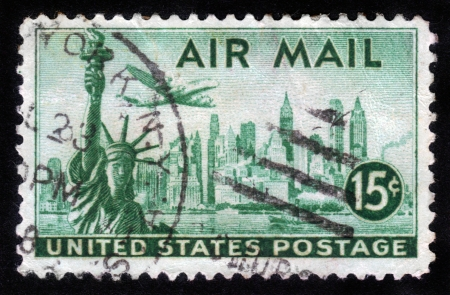 USA - CIRCA 1947: A stamp printed in the USA, shows the Statue of Liberty on the background the skyscrapers of New York, airliner Lockheed Constellation, circa 1947 Stock Photo - 14388396