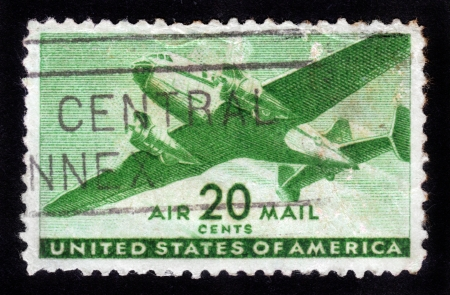UNITED STATES OF AMERICA - CIRCA 1950s: A stamp printed in the USA shows two engine transport plane, circa 1950s Stock Photo - 14388397