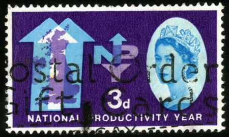 UNITED KINGDOM - CIRCA 1962  A stamp printed in UK shows a portrait of Queen Elizabeth II   NPY Emblem  National Productivity Year , circa 1962