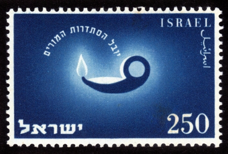 ISRAEL - CIRCA 1955  A stamp printed in the Israel shows image of the old oil lamps, issued in honor of 50th anniversary of the Teacher s Association, circa 1955