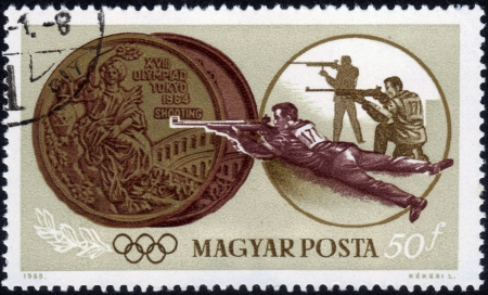 HUNGARY - CIRCA 1965  stamp printed by Hungary, shows two medals, shooting, Summer Olympics in Tokyo, series, circa 1965 Stock Photo - 14376592